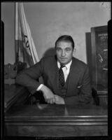 Victor McLaglen testifying at a trial, Los Angeles, 1935