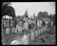 Women decorating graves at Rosedale cemetery, Los Angeles, 1922