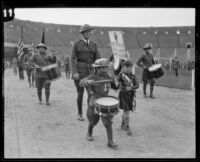 Young boys lead march at Memorial Day parade at the Coliseum, Los Angeles, 1926