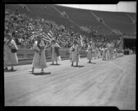 Women march in a Memorial Day parade at the Coliseum, Los Angeles, 1934