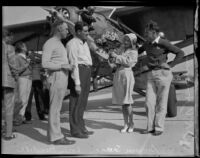 "R. V. ""Doc"" Howard and Gwen Seager bid farewell to Loren Mendell and Pete Reinhart before their takeoff, Los Angeles, 1929-1930"