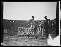 Paavo Nurmi runs toward finish line at Coliseum, Los Angeles, 1925