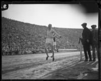 Paavo Nurmi crosses the finish line at the Coliseum, Los Angeles, 1925
