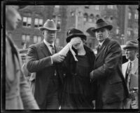 Murder suspect Madalynne Obenchain escorted to out of courthouse Los Angeles, ca. 1921