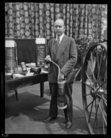 Arthur C. Burch with fire extinguishing equipment, Los Angeles, ca. 1920s