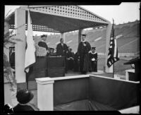 Rufus von Kleinsmid presents an honorary degree to Charles Wakefield Cadman at U.S.C. graduation ceremony, Los Angeles, 1926