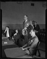Newton Kendall, Dorothy Garland, and Buron Fitts as Spike O'Donnell, standing, attends court, Los Angeles, circa 1934