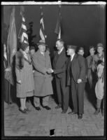 Ralph T. O'Neil shakes hands with an unidentified man, accompanied by wife Margaret O'Neil and John R. Quinn, Los Angeles, circa 1931