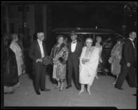 Mr. and Mrs. Charles Henry Thompson and Mrs. Osta Deardorff arrive at the opera after a meal at the Biltmore, Los Angeles, circa 1926