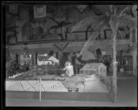 Child seated on the Escondido display at the National Orange Show, San Bernardino, 1933