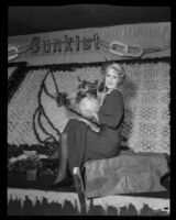 Ramona Franz holds a record size grapefruit at the National Orange Show, San Bernarndino, 1934
