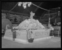Three women help to construct the Colton's display at the National Orange Show, San Bernardino, 1934
