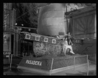 Four women pose on the Pasadena display at the National Orange Show, San Bernardino, 1930
