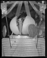 Woman emerges from the giant orange at the center of the Redlands display at the National Orange Show, San Bernardino, 1935