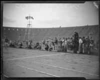 Charley Paddock crossing finish line at Los Angeles Memorial Coliseum, Los Angeles, 1928
