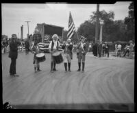Two drummers, a fief player, and a man carrying an American flag at the Pageant of Liberty, Los Angeles, 1926