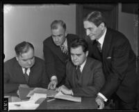 Joseph B. Keenan, Peirson Hall, Ernest R. Utley, and William Fleet Palmer discuss upcoming trial, Los Angeles, 1934-1935