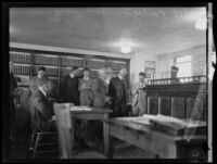 Alexander Pantages in courtroom with other men during his trial, Los Angeles, 1929