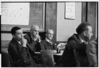 Alexander Pantages sitting at table with other men during his rape trial, Los Angeles, 1929