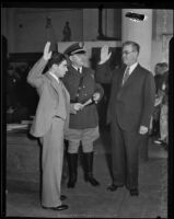 Judge Paonessa sworn in by Captain Cannon and Ray Cato, Los Angeles, 1933