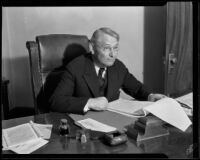 Superior Judge Parker reviews legal documents at his desk, Los Angeles, 1932