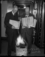 Treasurer Ned T. Powell and Deputy Treasurer Arthur McPherrin burning bonds, Los Angeles, 1934