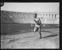 John Powers, Occidental College student, running track at the Coliseum, Los Angeles, circa 1924