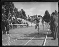 John Powers, Occidental College student, running a race, Los Angeles[?], circa 1924