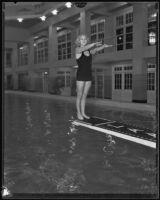 Dorothy Poynton, Olympic diver, posing in a backward dive start position, 1932