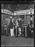 Waldo T. Tupper, Uncle John, and a child at the Los Angeles Times booth during the Eighth Annual National Radio Show, Los Angeles, 1930
