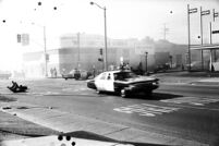 L.A. County Sheriff Dept. squad car speeding down Whittier Boulevard