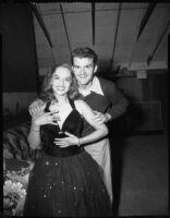 Woman and man posing, [Santa Monica?], 1951