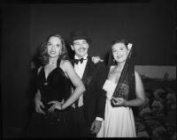 Two women and man posing, [Santa Monica?], 1951