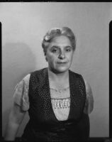 Woman in print dress, [1950s?]