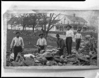 Men building rock wall, [1920s?, rephotographed 1940s?]