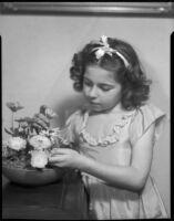 Sylvia Arslan arranging flowers, [1939-1940?]