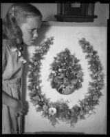 Young girl with horseshoe-shaped wreath of shells made in 1888 by poet Ina Donna Coolbrith, 1953