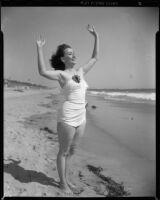 Betty Herrick [?] on beach, 1953-1964