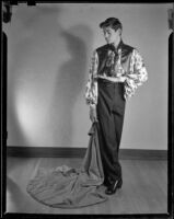 Young man posing in a Spanish style costume, Santa Monica, 1948-1950