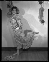 Barbara Lee Tramutto dancing in a muumuu and palm-frond hat, Santa Monica, 1951