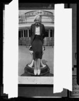 Young woman seated on bollard, Erie, Pennsylvania, [1936?]
