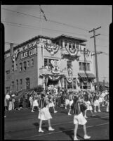 Marching band passing Elks Club building in Elks' parade, Santa Monica, 1939 or 1952