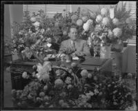 Santa Monica City Hall dedication, city official surrounded by flowers, Santa Monica, 1939