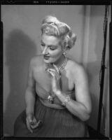 Ruth Crandall modelling an evening dress, Santa Monica, circa 1955