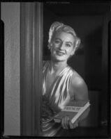 Ruth Crandall modeling a satin evening gown, Santa Monica, circa 1955