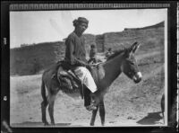 Zuni Indian man riding a donkey to his cornfield, copy print, New Mexico or Arizona, original photograph circa 1898