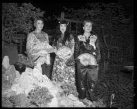 Three women wearing Chinese-style garments, 1950-1965