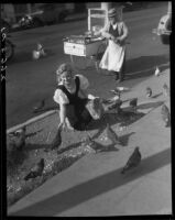 May Betteridge feeds popcorn to pigeons, Los Angeles, 1928-1934