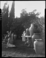 May Betteridge in a garden with large terracotta pots, Los Angeles, 1928-1934
