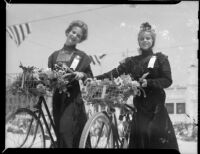 Young women with floral bicycles at the Annual Ocean Park Children's Floral Parade, Santa Monica, 1936